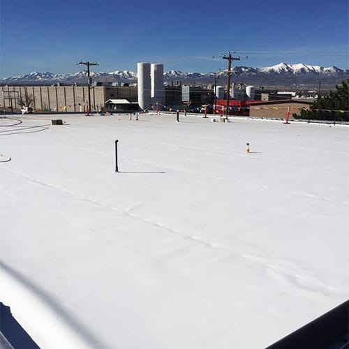 Waterproofed, flat commercial roof in the city.